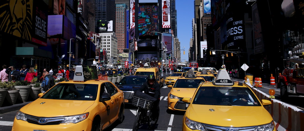 New York City taxi cabs drive through Times Square in New York March 29, 2016.  REUTERS/Lucas Jackson - GF10000364442