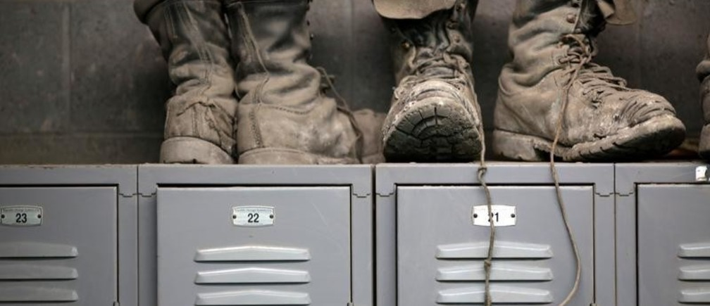 Coal mining boots are shown above miners' lockers before the start of an afternoon shift at a coal mine near Gilbert, West Virginia May 22, 2014.  REUTERS/Robert Galbraith/File Photo               GLOBAL BUSINESS WEEK AHEAD PACKAGE - SEARCH 'BUSINESS WEEK AHEAD 24 OCT'  FOR ALL IMAGES - S1AEUITDYIAA