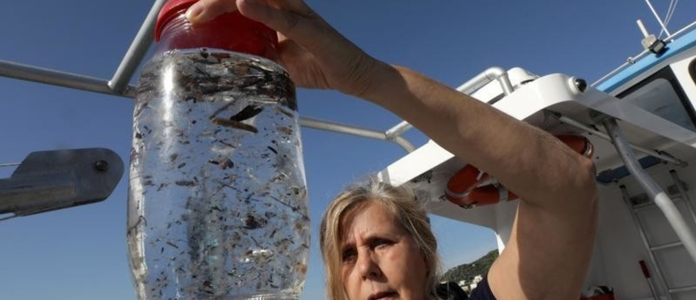 Maria-Luiza Pedrotti, CNRS marine biologist specialized in micro-plastics, looks at sea sample taken from the Mediterraneean Sea on a coastal research vessel as part of a scientific study about microplastics damaging marine ecosystems, near Villefranche-Sur-Mer, on the French Riviera, France, October 19, 2018. Picture taken October 19, 2018.