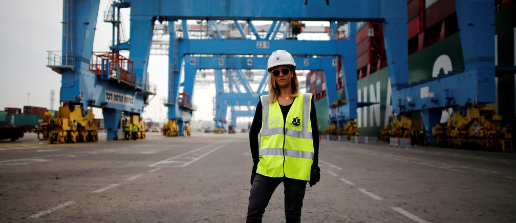 "Liz Azoulay, 26, who loads and unloads cargo at Ashdod port, poses for a photograph at the port, in Ashdod, southern Israel, February 22, 2017. ""In most of my professional life I did not face any inequality. In the port of Ashdod we are equal on the docks. I am the first woman who began working at the Ashdod port as a stevedore."" REUTERS/Amir Cohen SEARCH ""WOMEN WORK"" FOR THIS STORY. SEARCH ""WIDER IMAGE"" FOR ALL STORIES. - RC19E4D97240"