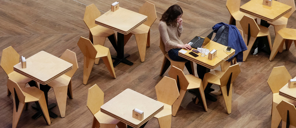 A woman uses a laptop at a cafe in the Central Universal Department Store (TsUM) in Kiev, Ukraine May 17, 2017. Picture taken May 17, 2017. REUTERS/Valentyn Ogirenko - RC19EA77AB30
