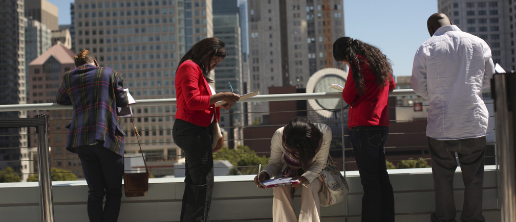Job seekers apply for the 300 available positions at a new Target retail store in San Francisco, California August 9, 2012.