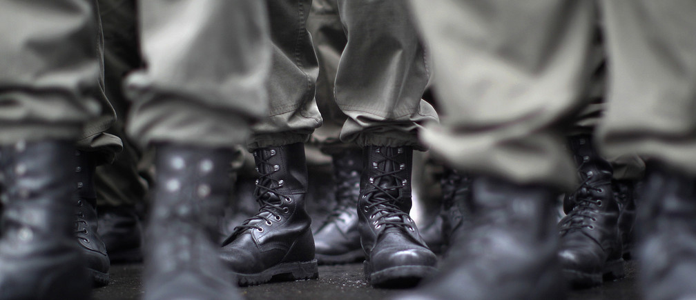 Boots of recruits of the Austrian armed forces (Bundesheer) are seen during the swear in ceremony on Austrian National Day (Nationalfeiertag) in Vienna October 26, 2011.   REUTERS/Lisi Niesner  (AUSTRIAPOLITICS - Tags: MILITARY) POLITICS) - RTR2T7Q1