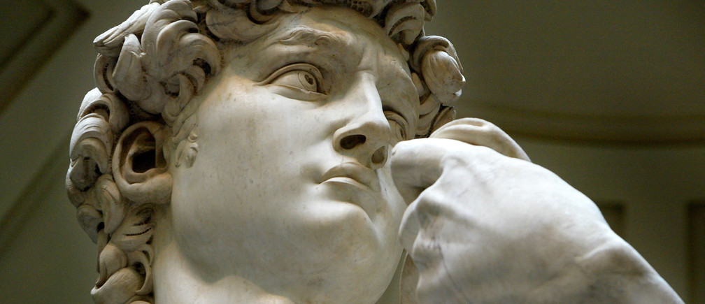 A close-up detail shows Michelangelo's statue of David at Accademia museum Florence