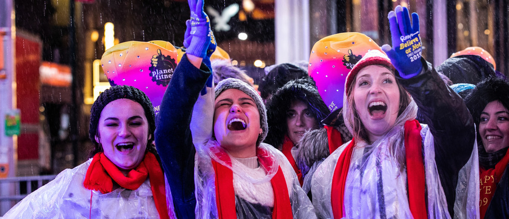 Revelers celebrate New Year's Eve in Times Square in the Manhattan borough of New York, U.S., December 31, 2018. REUTERS/Jeenah Moon - RC154DFE3610