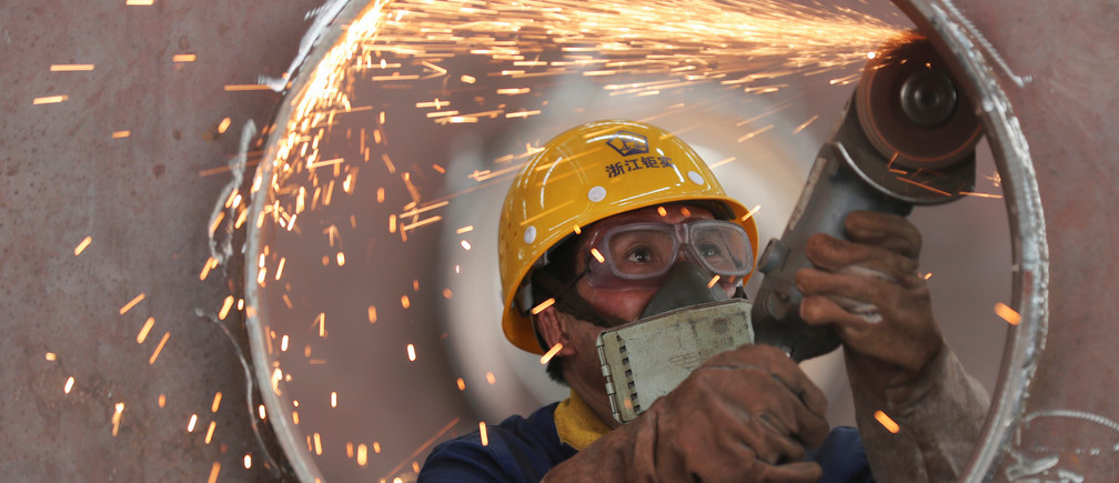 An employee works on a production line manufacturing steel structures at a factory in Huzhou, Zhejiang province, China May 17, 2020. Picture taken May 17, 2020. China Daily via REUTERS  ATTENTION EDITORS - THIS IMAGE WAS PROVIDED BY A THIRD PARTY. CHINA OUT. - RC2UQG91H2S9