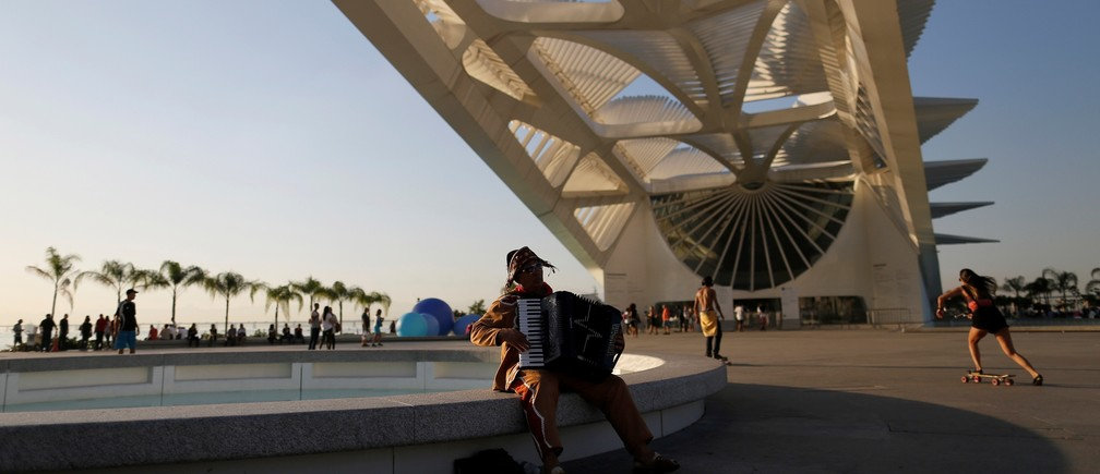 An accordionist is pictured in front of the Museum of Tomorrow in Rio de Janeiro, Brazil, July 12, 2016.