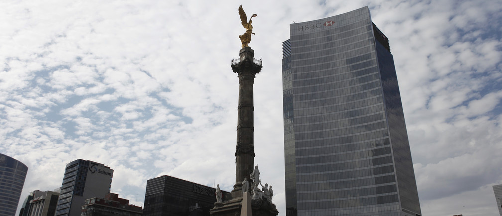 The Angel of Independence is seen near a building of HSBC in Mexico City, December 11, 2012.
