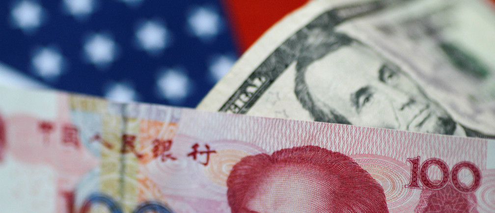 U.S. Dollar and China Yuan notes are seen in this picture illustration June 2, 2017. REUTERS/Thomas White/Illustration - RC1E290C4B00