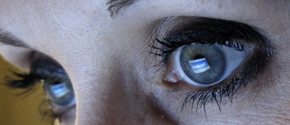 An illustration picture shows a woman looking at the Facebook website on a computer in Munich.