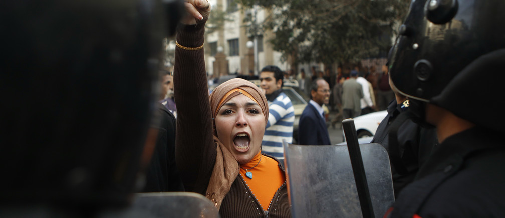 An anti-government protester gestures during clashes with police in Cairo January 26, 2011