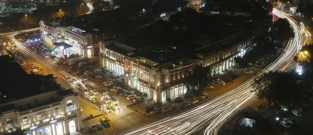 Vehicles move along New Delhi's Connaught Place during evening hours, October 28, 2014.