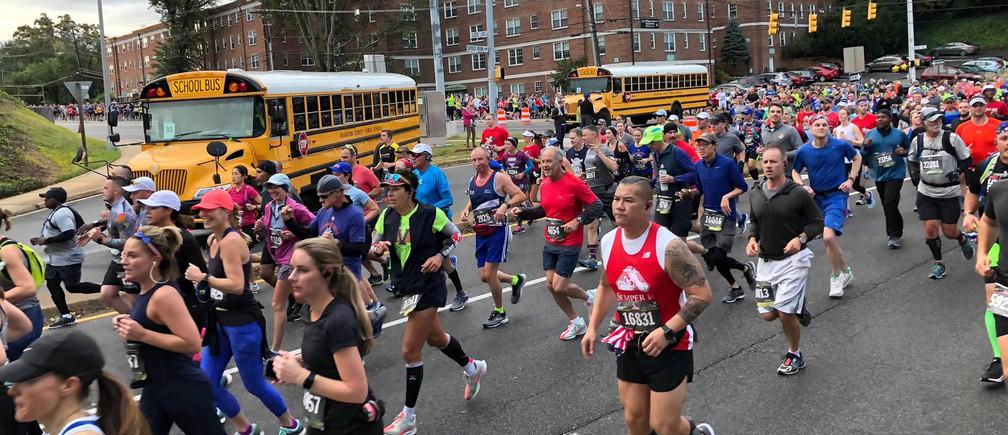 Participants run along the course of the annual Marine Corps Marathon in Arlington, Virginia, U.S., October 28, 2018.   REUTERS/Will Dunham - RC1EBA14EC30