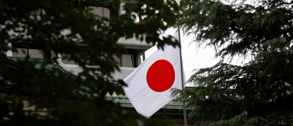 A Japanese flag flutters atop the Bank of Japan building in Tokyo, Japan, September 21, 2016.  REUTERS/Toru Hanai - RTSOPF5