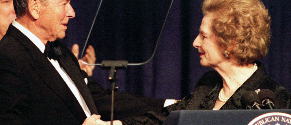 Former British Prime Minister Margaret Thatcher (R) shakes hands with former U.S. President Ronald Reagan as she participates in a birthday salute celebrating Reagan's 83rd birthday, February 3 in Washington. While at the $1,000 a plate fund-raising dinner, Reagan said the Democrats were trying to rewrite the history of his eight years in power and accused President Clinton of stealing Republican ideas for his recent State of the Union message.HB - RTR2EAL
