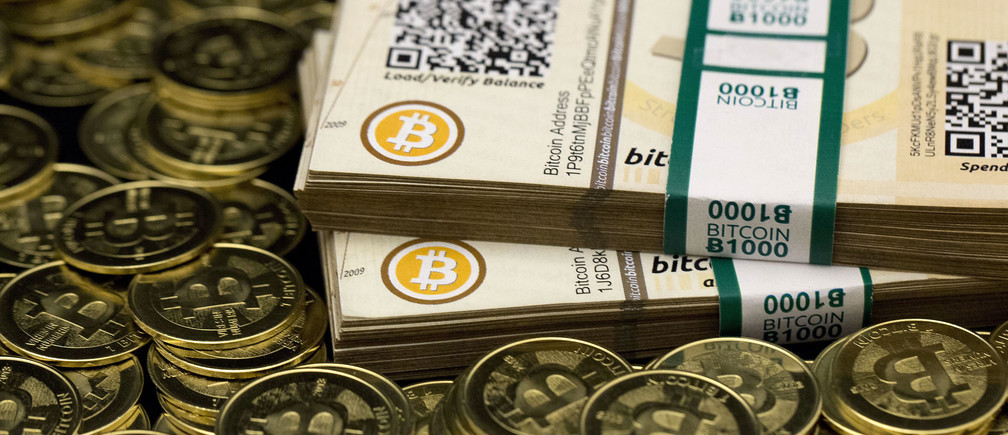 "Some of Bitcoin enthusiast Mike Caldwell's coins and paper vouchers, often called ""paper wallets"", are pictured at his office in this photo illustration in Sandy, Utah, January 31, 2014."