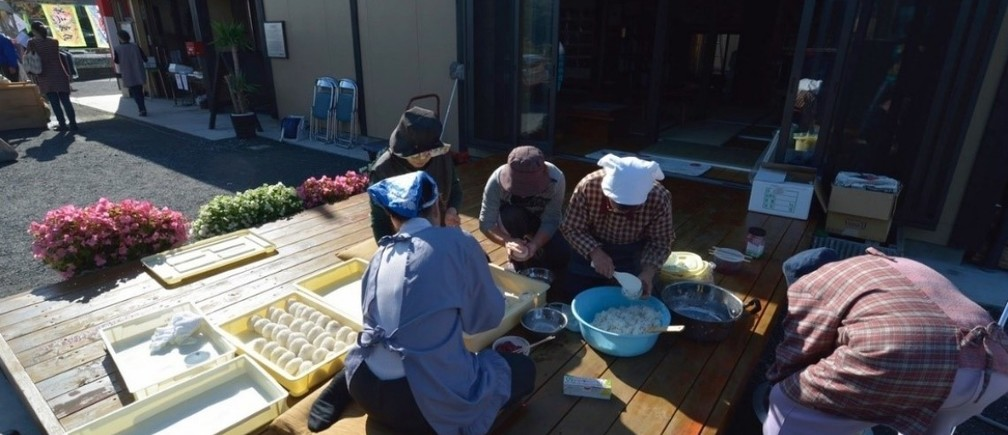 Local women cooking for the community hub while recovering from the Great East Japan Earthquake