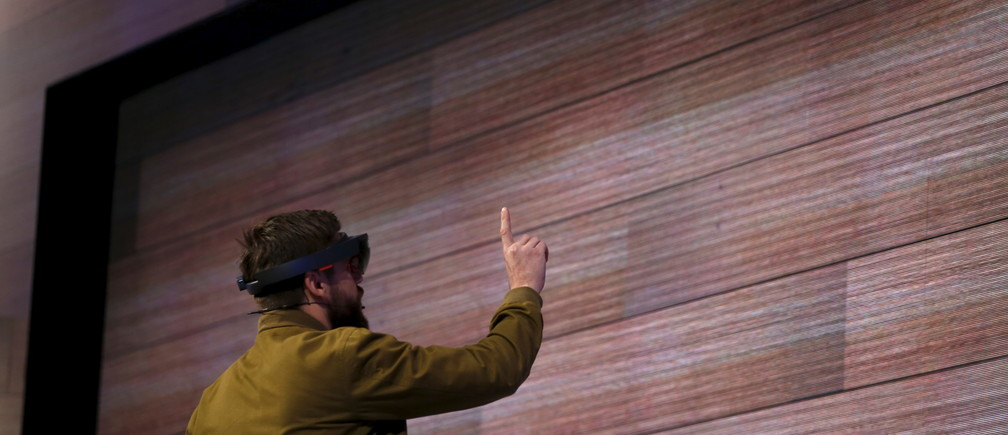 A man wears a device featuring Windows Holographic technology at Microsoft Build in San Francisco, California April 29, 2015. REUTERS/Robert Galbraith - GF10000077687