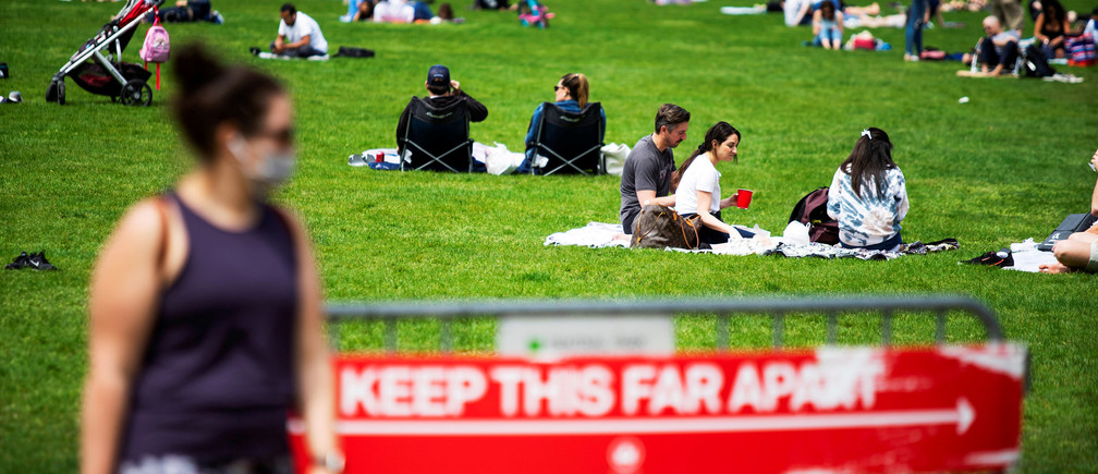 People rest and enjoy the day at Central Park maintaining social distancing norms, during the outbreak of the coronavirus disease (COVID-19) in the Manhattan borough of New York City, U.S., May 2, 2020. REUTERS/Eduardo Munoz     TPX IMAGES OF THE DAY - RC2KGG9HZT9C