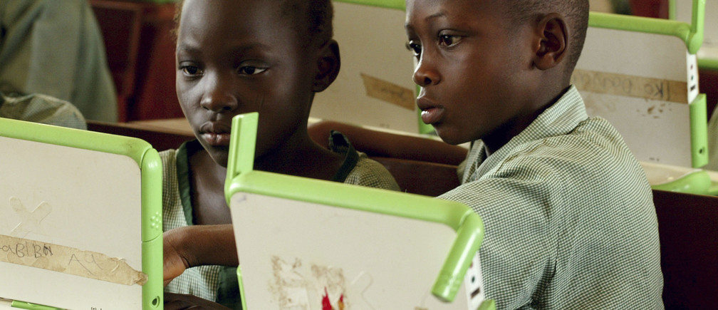 "Nigerian pupils work on computers at the LEA primary school in Abuja, in this May 30, 2007 picture. The school is a pilot site for the ""One laptop per child"" project, a non profit organisation aimed at providing children in the world with a means to express their potential. Reuters/Afolabi Sotunde (NIGERIA) BEST QUALITY AVAILABLE - RTR1QCYK"