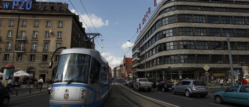 A tram travels through the central shopping district of Wroclaw, southern-western Poland, July 28, 2011. Wroclaw is one of the four Polish venues where next year EURO 2012 soccer championships will be hosted. REUTERS/Kacper Pempel (POLAND - Tags: BUSINESS CONSTRUCTION SPORT SOCCER) - RTR2PQIF