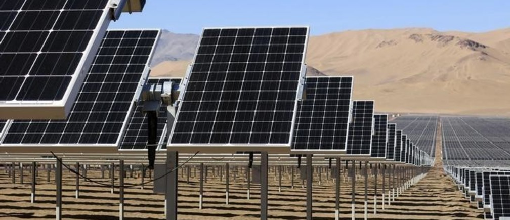Solar panels of local mining company CAP are seen in the Atacama Desert June 5, 2014. CAP inaugurated the largest solar plant in Latin America with an area equivalent to 200 football fields and to generate enough power to meet almost all the electrical needs of an iron ore mine. The arid northern part of Chile and the southern Patagonia are ideal to generate, solar, wind or geothermal power. Picture taken June 5, 2014.  REUTERS/Fabian Andres Cambero (CHILE - Tags: ENERGY ENVIRONMENT)