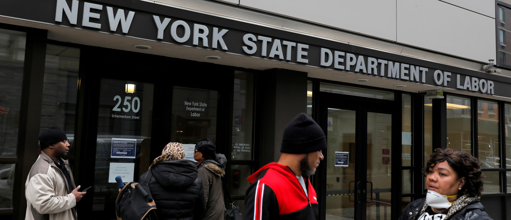 People gather at the entrance for the New York State Department of Labor offices, which closed to the public due to the coronavirus disease (COVID-19) outbreak in the Brooklyn borough of New York City, U.S., March 20, 2020.