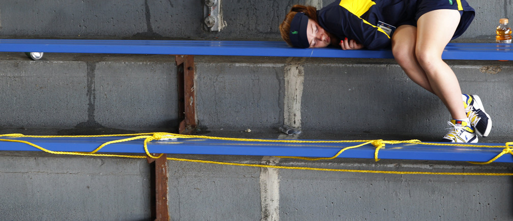 A girl naps in the stands at the U.S. Open tennis tournament in New York August 27, 2012. REUTERS/Jessica Rinaldi (UNITED STATES  - Tags: SPORT TENNIS) - TB3E88R1MH73E