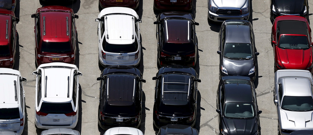 FILE PHOTO - Cars are seen in a parking lot in Palm Springs, California April 13, 2015. Picture taken April 13, 2015.  REUTERS/Lucy Nicholson/File Photo - RC152373E6E0