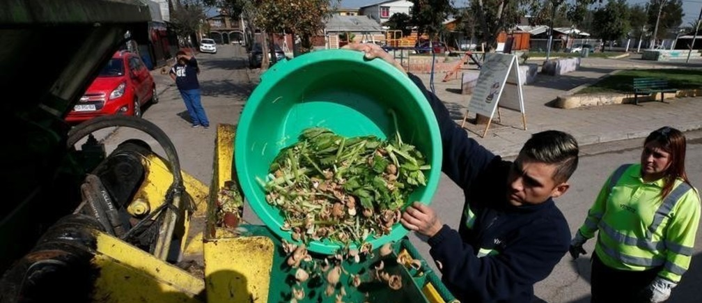 Municipal employees collect vegetable waste from homes in a neighbourhood to prepare compost,  in Santiago, Chile May 9, 2019. Picture taken May 9, 2019.  REUTERS/Rodrigo Garrido - RC146A1E8740