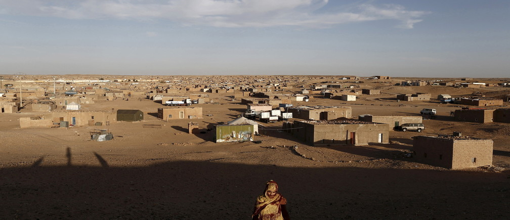 "An indigenous Sahrawi woman walks at a refugee camp of Boudjdour in Tindouf, southern Algeria March 3, 2016. In refugee camps near the town of Tindouf in arid southern Algeria, conditions are hard for indigenous Sahrawi residents. Residents use car batteries for electricity at night and depend on humanitarian aid to get by. The five camps near Tindouf are home to an estimated 165,000 Sahrawi refugees from the disputed region of Western Sahara, according to the United Nations refugee agency UNHCR. REUTERS/Zohra Bensemra      TPX IMAGES OF THE DAY      SEARCH ""THE WIDER IMAGE"" FOR ALL STORIES   Matching text ALGERIA-SAHARA/ - RTS9CDG"