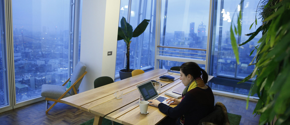 A worker sits in the garden room in the Jellyfish office space in London, Britain December 19, 2016. Picture taken December 19, 2016. REUTERS/Neil Hall  - RTX2W5CM
