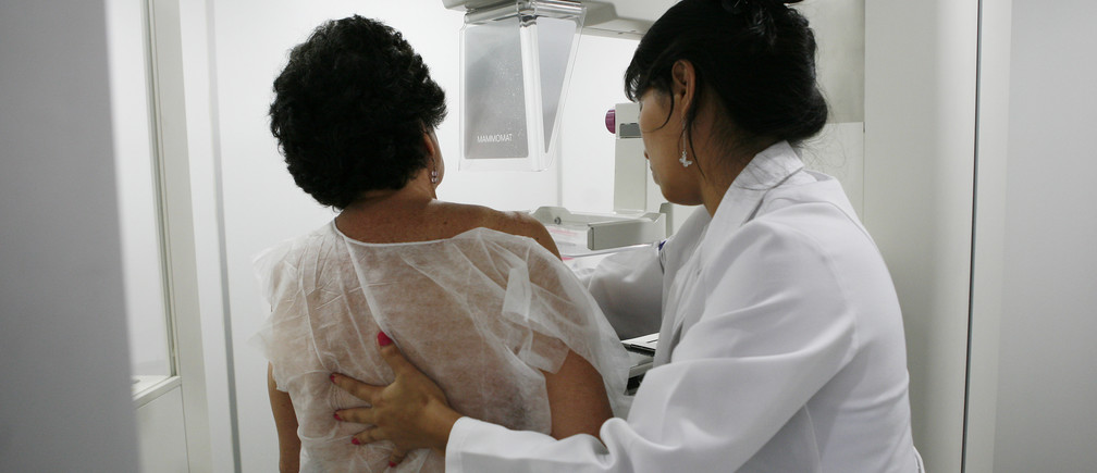 A woman undergoes a free mammogram inside Peru's first mobile unit for breast cancer detection, in Lima March 8, 2012. International Women's Day falls on March 8. REUTERS/Enrique Castro-Mendivil (PERU - Tags: HEALTH) - GM1E8390T4I01