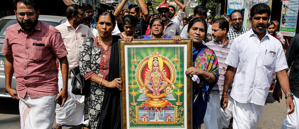 "Protesters hold a portrait of Hindu deity ""Ayappa"" as they take part in a rally called by various Hindu organisations after two women entered the Sabarimala temple, in Kochi, India, January 2, 2019. REUTERS/Sivaram V - RC15D0A67BD0"