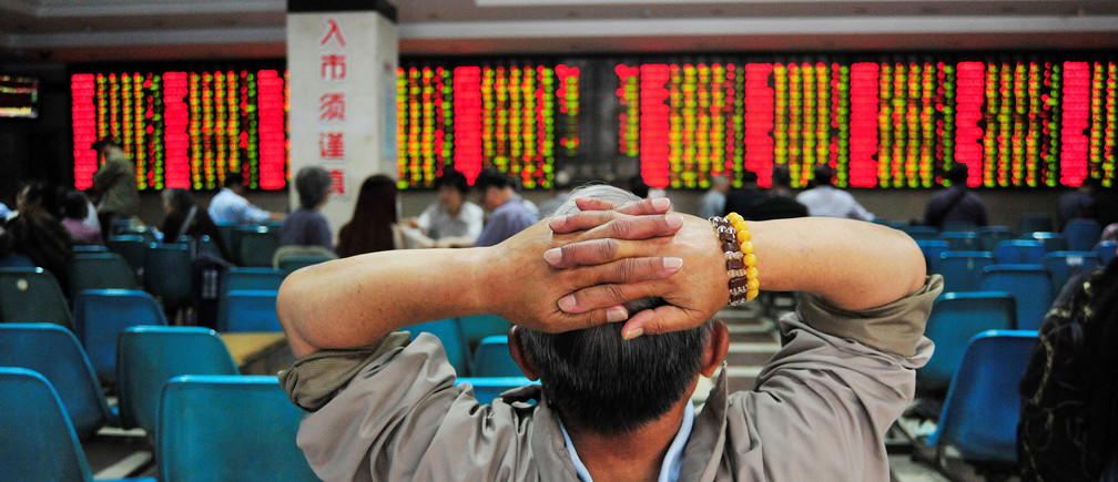 An investor looks at an electronic board showing stock information at a brokerage house in Nanjing, China May 24, 2017. REUTERS/Stringer ATTENTION EDITORS - THIS IMAGE WAS PROVIDED BY A THIRD PARTY. EDITORIAL USE ONLY. CHINA OUT. - RTX37DIY