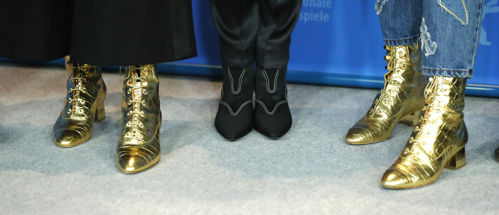 "The shoes of director and screenwriter Joanna Hogg and actresses Tilda Swinton and  Honor Swinton Byrne are pictured during a photocall to promote the movie ""The Souvenir"" at the 69th Berlinale International Film Festival in Berlin, Germany, February 12, 2019. REUTERS/Fabrizio Bensch - UP1EF2C165DL0"