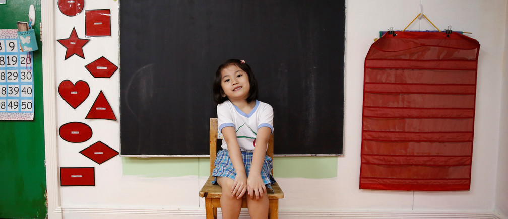 "Jaedene Alyzxandra Medina, 5, poses for a photograph inside her classroom at Child's Home Educational Center in Las Pinas, Metro Manila Philippines, November 29, 2016. REUTERS/Erik De Castro           SEARCH ""CHRISTMAS WISHES"" FOR THIS STORY. SEARCH ""WIDER IMAGE"" FOR ALL STORIES. - RC162348C510"