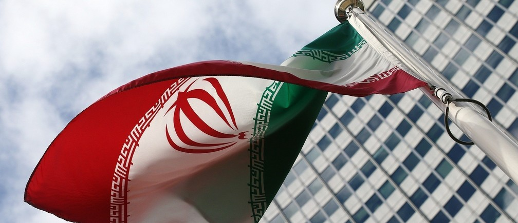 An Iranian flag flutters in front of the United Nations headquarters, during an International Atomic Energy Agency (IAEA) board of governors meeting, in Vienna, March 4, 2015. The U.N. nuclear watchdog chief said on Monday Iran was being slow to cooperate with his agency's investigation into the Iranian atomic programme and that the inquiry could not continue indefinitely.  REUTERS/Heinz-Peter Bader (AUSTRIA - Tags: POLITICS ENERGY) - RTR4S0LT