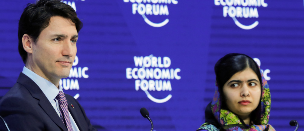 Canada's Prime Minister Justin Trudeau and Nobel laureate Malala Yousafzai at the 2018 World Economic Forum annual meeting in Davos