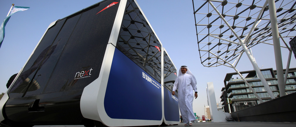 A man walks past the world's first autonomous pods which was launched by the Roads and Transport Authority of Dubai in Dubai, United Arab Emirates February, 28, 2018. Picture taken February, 28, 2018. REUTERS/Satish Kumar - RC1BA7C68C00