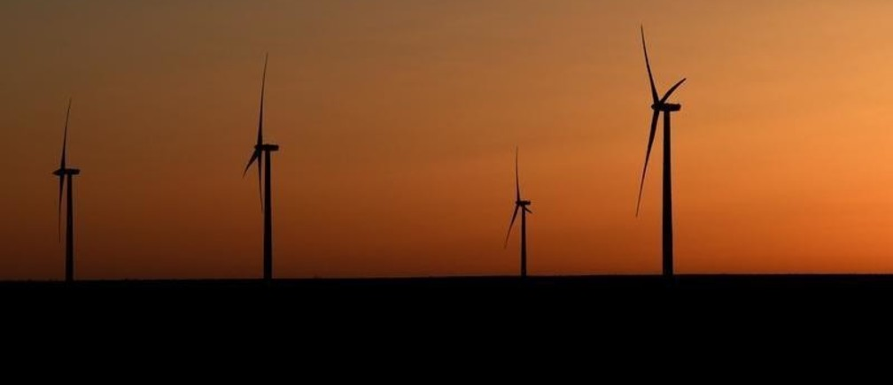 Wind turbines operate at sunrise in the Permian Basin oil and natural gas production area in Big Spring, Texas U.S. February 12, 2019. Picture taken February 12, 2019.  REUTERS/Nick Oxford - RC1C57D3EF30