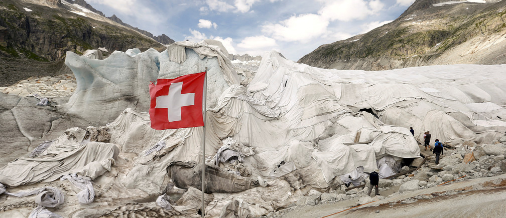 White canvas covers protect parts of the Rhone glacier against melting as visitors enter an ice cave near the Furka mountain pass at 2429 metres (7969 ft) altitude in the Swiss Alps, Switzerland August 6, 2015.