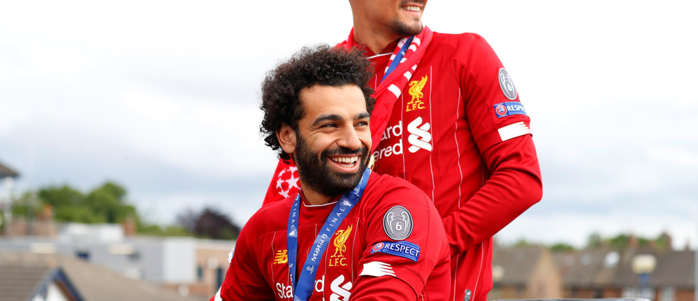 Soccer Football - Champions League - Liverpool victory parade - Liverpool, Britain - June 2, 2019  Liverpool's Mohamed Salah and Dejan Lovren during the victory parade  REUTERS/Phil Noble - RC130E2D8810