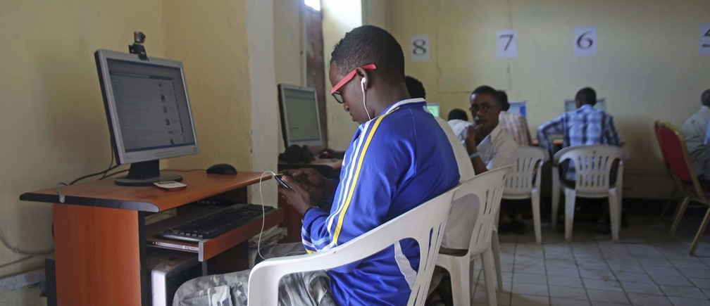People use computers at an internet cafe in the Hodan area of Mogadishu October 9, 2013.