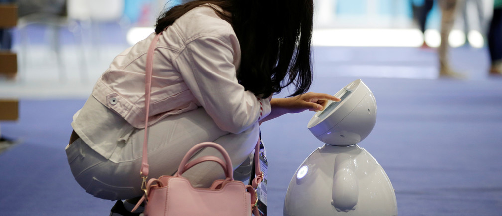 A staff member sets up a ROBOTLEO robot  at the Global Mobile Internet Conference (GMIC) 2017 in Beijing, China April 28, 2017. REUTERS/Jason Lee - RTS149M8