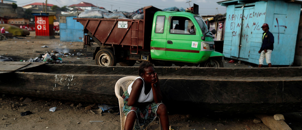A woman looks on in Jamestown, Accra, Ghana November 28, 2018. REUTERS/Zohra Bensemra - RC1D09E7A380