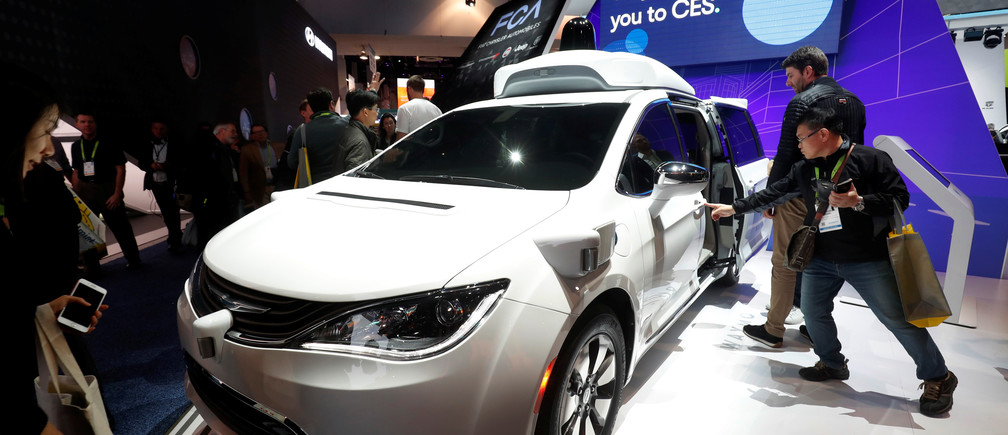 A Waymo autonomous vehicle (formerly the Google self-driving car project) is displayed at the Fiat Chrysler Automobiles booth during the 2019 CES in Las Vegas, Nevada, January 2019.