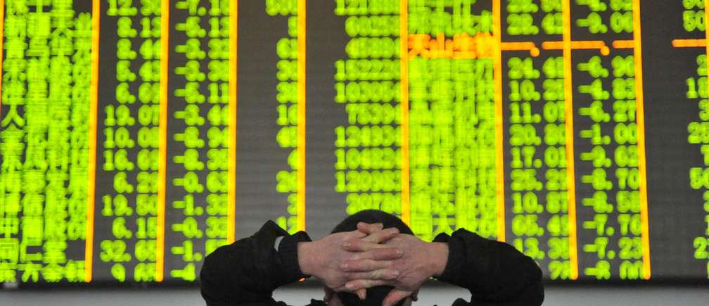 FILE PHOTO: An investor looks at an electronic screen at a brokerage house in Hangzhou, Zhejiang province, January 26, 2016.  REUTERS/China Daily ATTENTION EDITORS - THIS PICTURE WAS PROVIDED BY A THIRD PARTY. THIS PICTURE IS DISTRIBUTED EXACTLY AS RECEIVED BY REUTERS, AS A SERVICE TO CLIENTS. CHINA OUT. NO COMMERCIAL OR EDITORIAL SALES IN CHINA - RTX3BUOG
