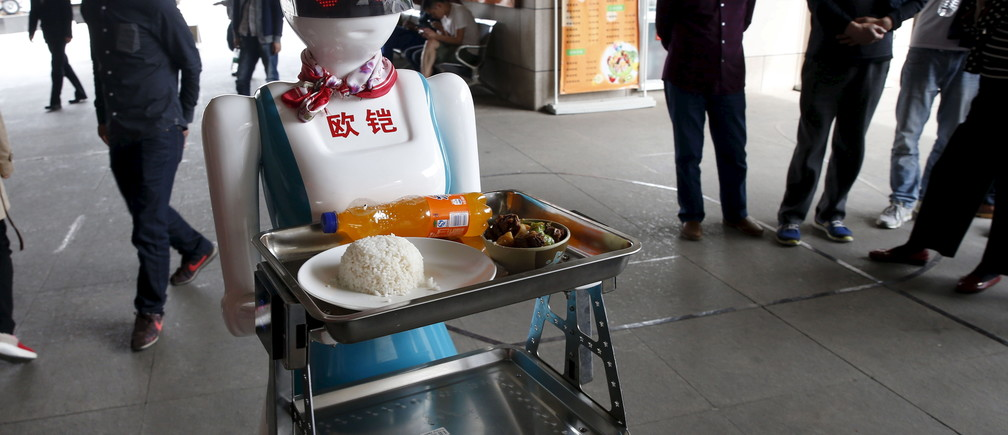 A robot works as a waitress for a restaurant in Xi'an, Shaanxi Province, China, April 20, 2016. REUTERS/Stringer ATTENTION EDITORS - THIS PICTURE WAS PROVIDED BY A THIRD PARTY. THIS PICTURE IS DISTRIBUTED EXACTLY AS RECEIVED BY REUTERS, AS A SERVICE TO CLIENTS. CHINA OUT. NO COMMERCIAL OR EDITORIAL SALES IN CHINA.       TPX IMAGES OF THE DAY - GF10000391895