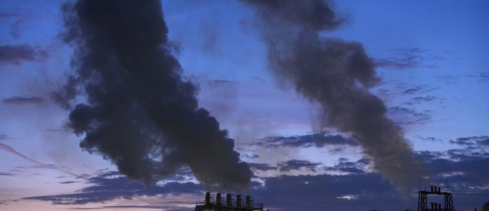 "Smoke billows from the chimneys of a wood products factory near the city of Burgos, northern Spain  December 9, 2009. The biggest climate meeting in history, with 15,000 participants from 192 nations, opened in Copenhagen on Monday with hosts Denmark saying an unmissable opportunity to protect the planet was ""within reach"".  REUTERS/Felix Ordonez (SPAIN ENVIRONMENT ENERGY IMAGES OF THE DAY) - GM1E5CA082501"